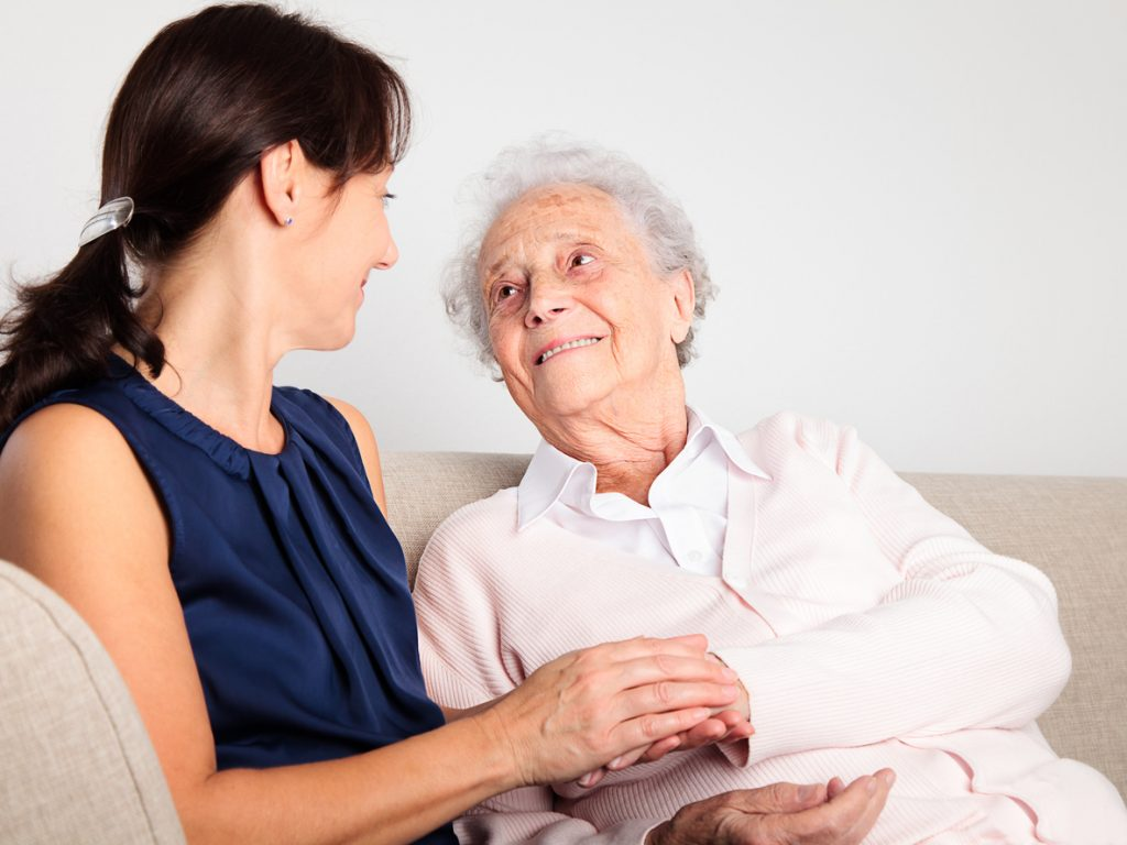 Senior woman with her home caregiver. Healthy Dementia Care concept