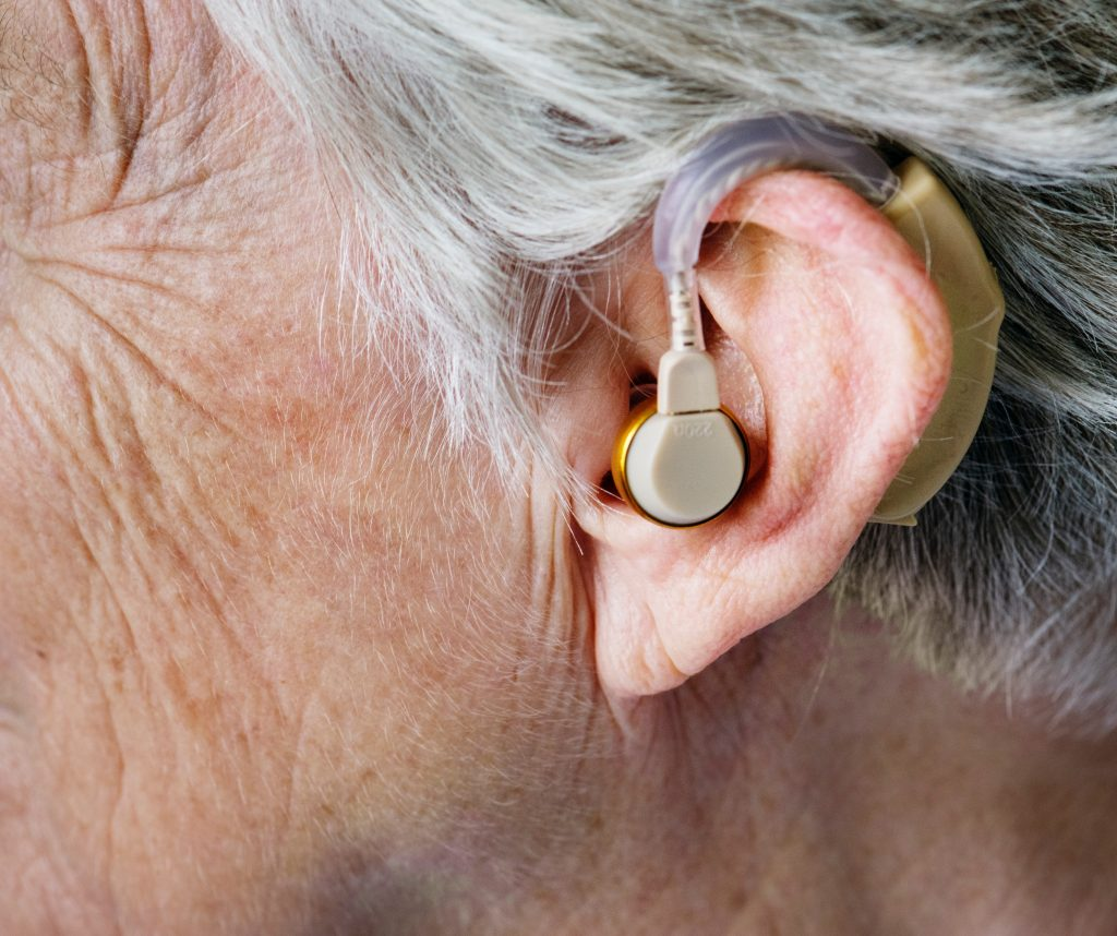 woman with a hearing aid in
