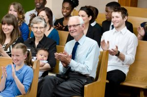 Elderly and family at a church service