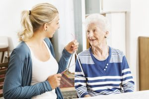 treating elderly woman with music therapy